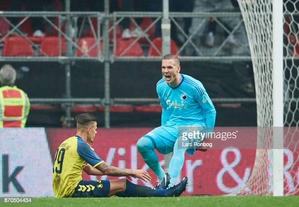 Goalkeeper Robin Olsen of FC Copenhagen shows frustration against Jan Kliment of Brondby IF during the Danish Alka Superliga match between FC...