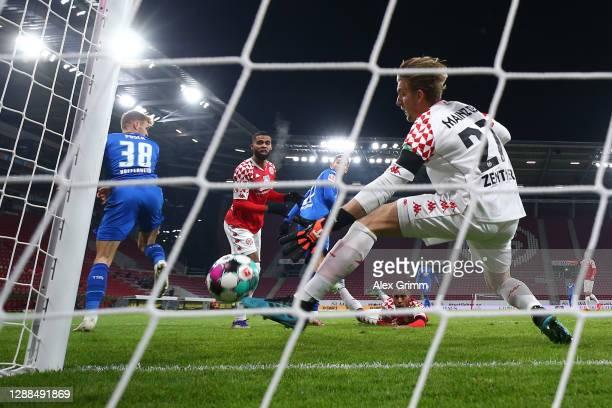 Goalkeeper Robin Zentner of Mainz makes a save against Stefan Posch of Hoffenheim during the Bundesliga match between 1. FSV Mainz 05 and TSG...