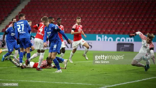 Goalkeeper Robin Zentner of Mainz saves a header from Stefan Posch of Hoffenheim during the Bundesliga match between 1. FSV Mainz 05 and TSG...