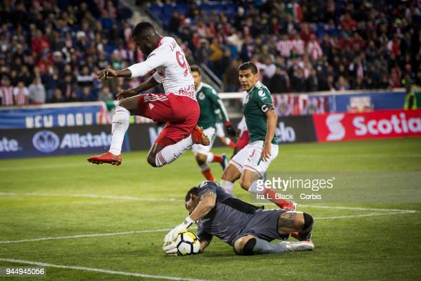 Goalkeeper Rodolfo Cota of Guadalajara blocks the shot on goal by Kemar Lawrence of New York Red Bulls during the CONCACAF Champions League...