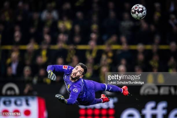 Goalkeeper Roman Bürki of Dortmund observes the ball during the Bundesliga match between Borussia Dortmund and Bayer 04 Leverkusen at Signal Iduna...