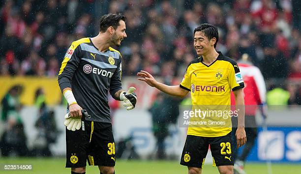 goalkeeper Roman Buerki and Shinji Kagawa of Borussia Dortmund celebrate after winning the Bundesliga match between VfB Stuttgart v Borussia Dortmund...