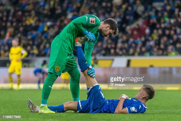 Goalkeeper Roman Buerki of Borussia Dortmund and Christoph Baumgartner of TSG 1899 Hoffenheim gestures during the Bundesliga match between TSG 1899...