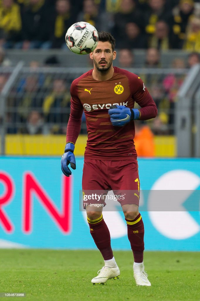 273a22a1c Goalkeeper Roman Buerki of Borussia Dortmund controls the ball ...