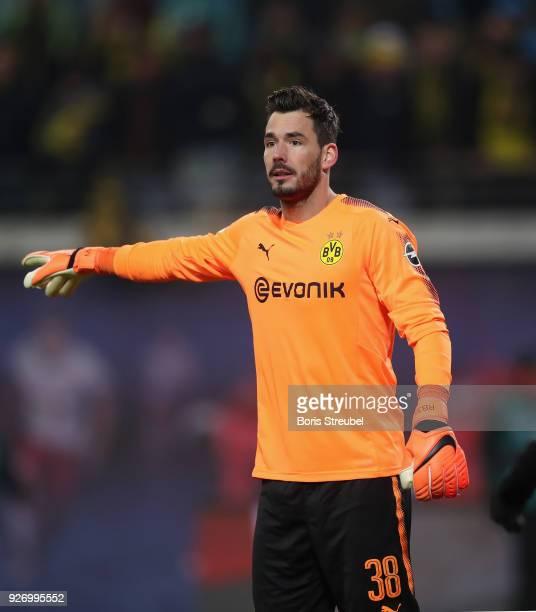 Goalkeeper Roman Buerki of Borussia Dortmund gestures during the Bundesliga match between RB Leipzig and Borussia Dortmund at Red Bull Arena on March...