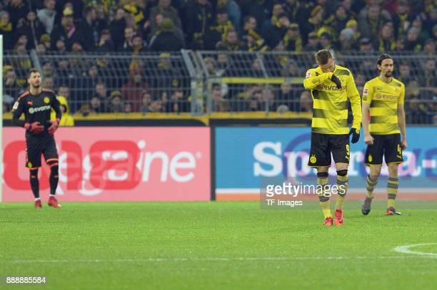 Goalkeeper Roman Buerki of Dortmund Andrey Yarmolenko of Dortmund and Neven Subotic of Dortmund look dejected during the Bundesliga match between...