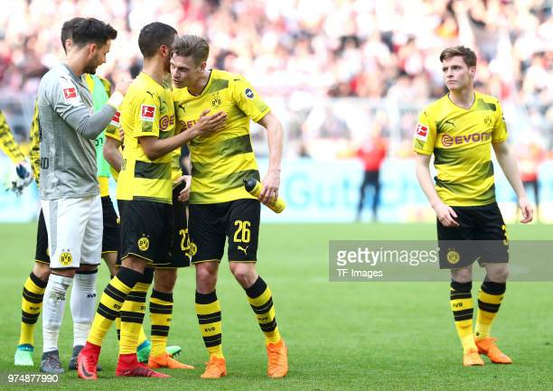 Goalkeeper Roman Buerki of Dortmund Jeremy Toljan of Dortmund and Lukasz Piszczek of Dortmund Sergio Gomez of Dortmund celebrate after winning the...