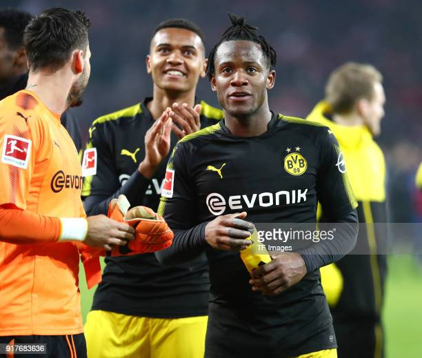 Goalkeeper Roman Buerki of Dortmund Manuel Akanji of Dortmund and Michy Batshuayi of Dortmund celebrate after winning the Bundesliga match between 1...