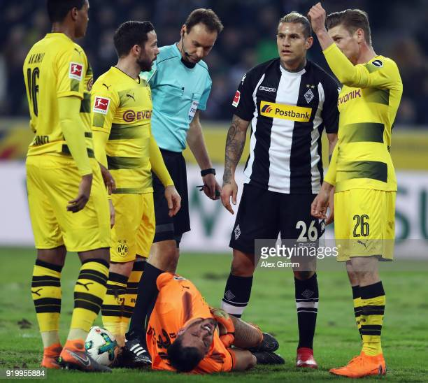Goalkeeper Roman Buerki of Dortmund reacts after being hit by Raul Bobadilla of Moenchengladbach during the Bundesliga match between Borussia...