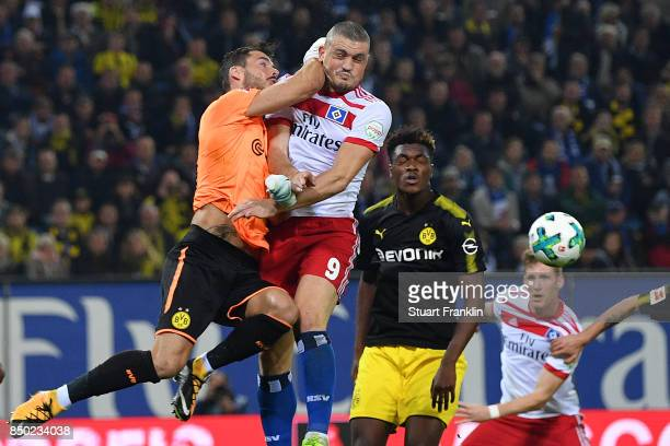 Goalkeeper Roman Buerki of Dortmund saves against Kyriakos Papadopoulos of Hamburg during the Bundesliga match between Hamburger SV and Borussia...