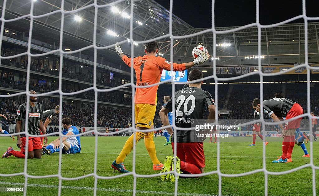 Goalkeeper Roman Buerki of Freiburg and his teammates react after the third goal of Jannik Vestergaard of Hoffenheim during the Bundesliga match between TSG 1899 Hoffenheim and SC Freiburg at Wirsol Rhein-Neckar-Arena on September 23, 2014 in Sinsheim, Germany.