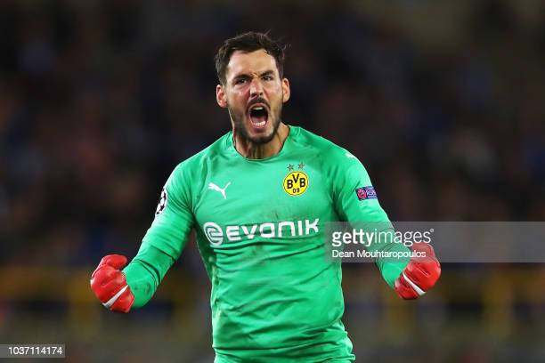 Goalkeeper Roman Burki of Borussia Dortmund celebrates his team scoring a goal during the Group A match of the UEFA Champions League between Club...