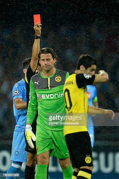 Goalkeeper Roman Weidenfeller of Borussia Dortmund is shown the red card during the UEFA Champions League Group F match between SSC Napoli and...
