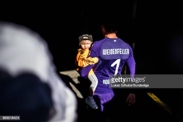Goalkeeper Roman Weidenfeller of Dortmund and his son leave the pitch after last match at home after the Bundesliga match between Borussia Dortmund...
