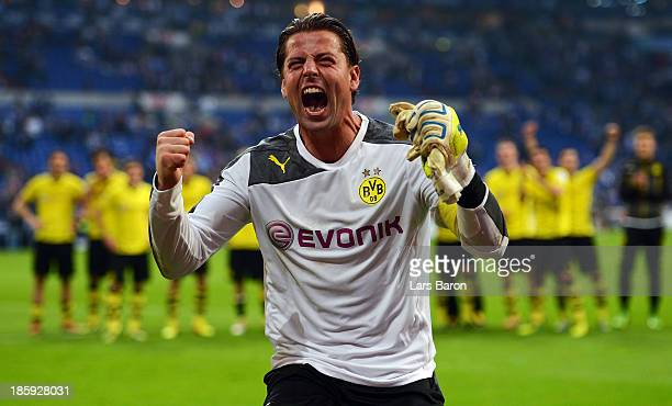 Goalkeeper Roman Weidenfeller of Dortmund celebrates after winning the Bundesliga match between FC Schalke 04 and Borussia Dortmund at VeltinsArena...