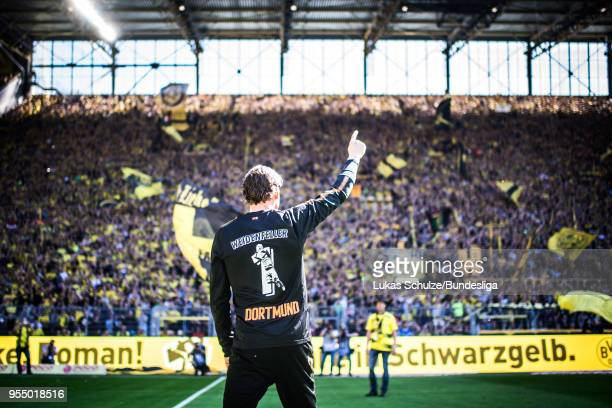 Goalkeeper Roman Weidenfeller of Dortmund celebrates his last home match with fans of the Suedtribuene prior to the Bundesliga match between Borussia...