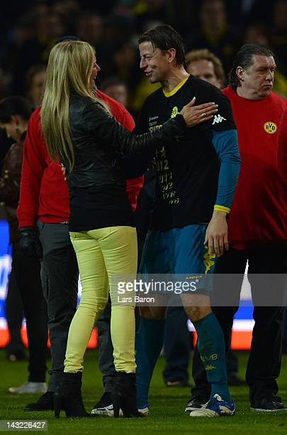 Goalkeeper Roman Weidenfeller of Dortmund celebrates with Ulla Klopp wife of head coach Juergen Klopp after winning the Bundesliga match between...