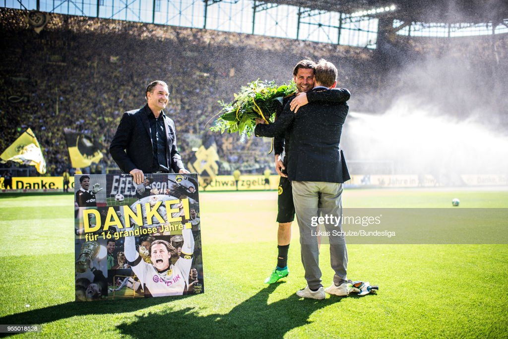 Goalkeeper Roman Weidenfeller (C) of Dortmund gets presents for his last home match for Borussia Dortmund prior to the Bundesliga match between Borussia Dortmund and 1. FSV Mainz 05 at Signal Iduna Park on May 5, 2018 in Dortmund, Germany.