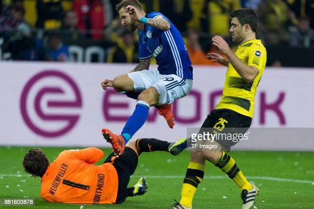 Goalkeeper Roman Weidenfeller of Dortmund Guido Burgstaller of Schalke and Sokratis of Dortmund battle for the ball during the Bundesliga match...