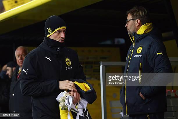 Goalkeeper Roman Weidenfeller of Dortmund walks past head coach Juergen Klopp prior to the Bundesliga match between Borussia Dortmund and 1899...