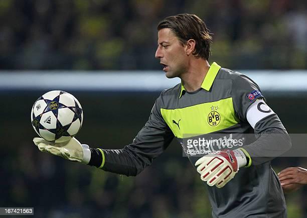 Goalkeeper Roman Weidenfeller of Dortmund watches the Champions League ball during the UEFA Champions League semi final first leg match between...