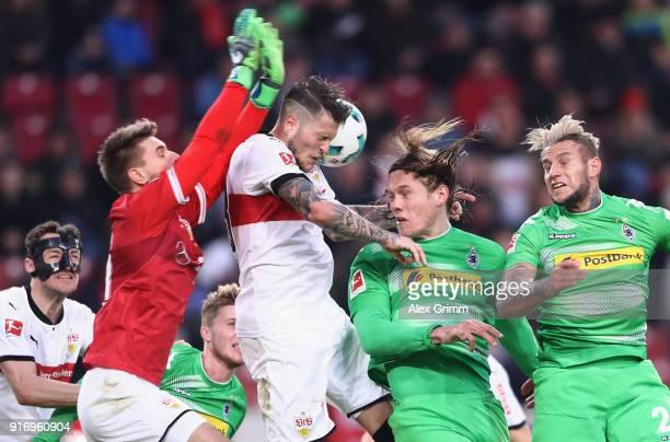 Goalkeeper RonRobert Zieler and Daniel Ginczek of Stuttgart battle for the ball with Jannik Vestergaard and Raul Bobadilla of Moenchengladbach during...