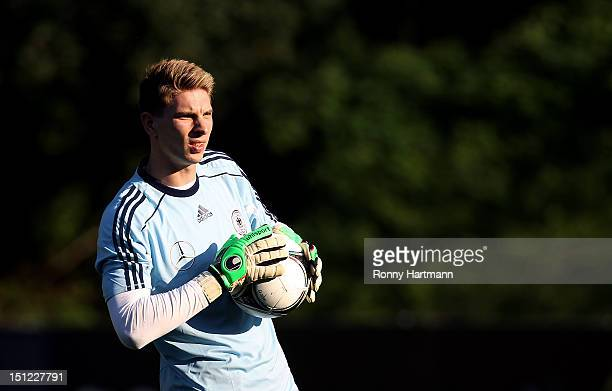 Goalkeeper Ron-Robert Zieler of Germany holds the ball during a training session on September 04, 2012 in Barsinghausen, Germany, three days before...
