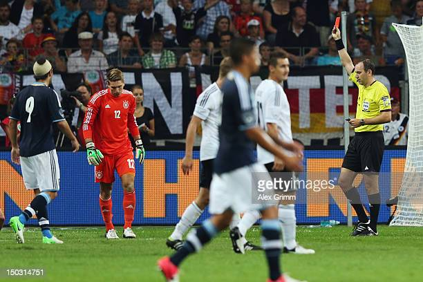 Goalkeeper RonRobert Zieler of Germany is sent off by referee Jonas Eriksson during the international friendly match between Germany and Argentina at...