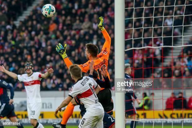 Goalkeeper RonRobert Zieler of Stuttgart and Corentin Tolisso of Muenchen battle for the ball during the Bundesliga match between VfB Stuttgart and...