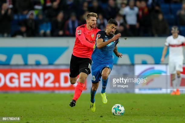 Goalkeeper RonRobert Zieler of Stuttgart and Kerem Demirbay of Hoffenheim battle for the ball during the Bundesliga match between TSG 1899 Hoffenheim...