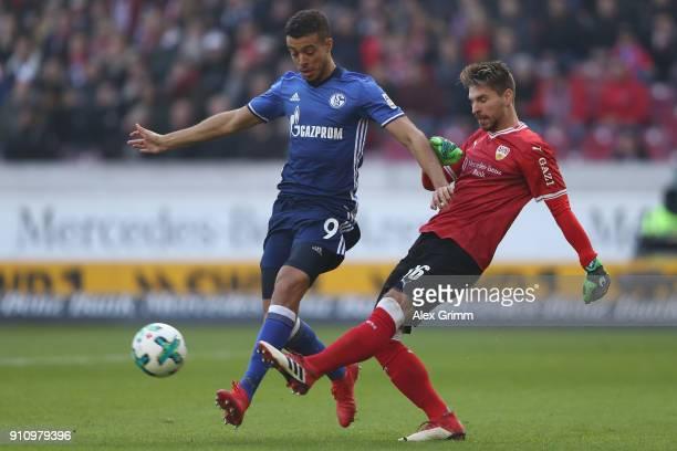 Goalkeeper RonRobert Zieler of Stuttgart clears the ball ahead of Franco di Santo of Schalke during the Bundesliga match between VfB Stuttgart and FC...