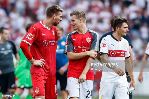 Goalkeeper RonRobert Zieler of Stuttgart Dzenis Burnic of Stuttgart celebrate their win during the Bundesliga match between VfB Stuttgart and 1FSV...