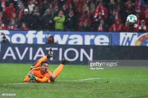 Goalkeeper RonRobert Zieler of Stuttgart lets in Mainz' third goal from Gerrit Holtmann during the Bundesliga match between 1 FSV Mainz 05 and VfB...
