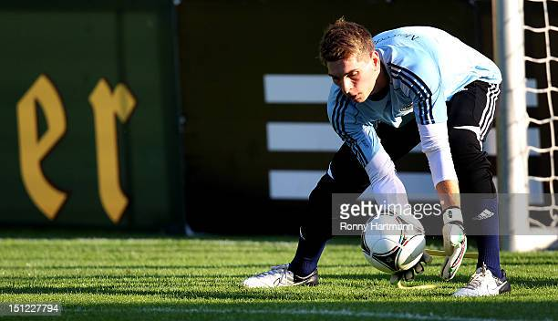 Goalkeeper Ron-Robert Zieler saves the ball during a training session on September 04, 2012 in Barsinghausen, Germany, three days before their FIFA...