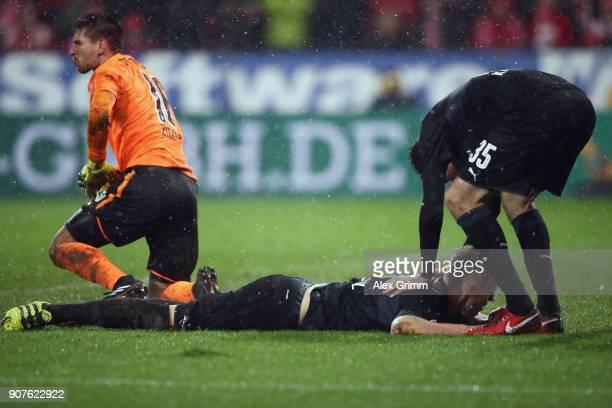 Goalkeeper RonRobert Zieler Timo Baumgartl and Marcin Kaminski of Stuttgart react during the Bundesliga match between 1 FSV Mainz 05 and VfB...