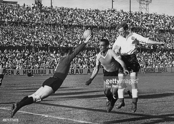 Goalkeeper Roque Gaston Maspoli makes a save from Tom Finney as Omar Oscar Miguez defends during the quarter final match between England and Uruguay...