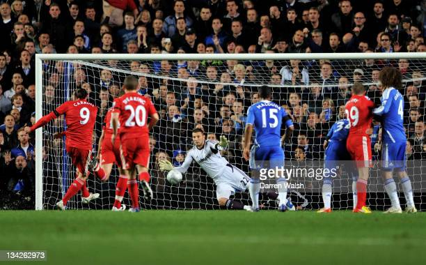 Goalkeeper Ross Rurnbull of Chelsea saves the penalty attempt by Andy Carroll of Liverpool during the Carling Cup quarter final match between Chelsea...
