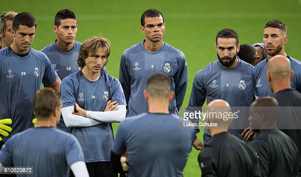 Goalkeeper Ruben Yanez James Rodriguez Luka Modric Pepe Daniel Carvajal and Pepe of Madrid listen to Head Coach Zinedine Zidane of Madrid during the...