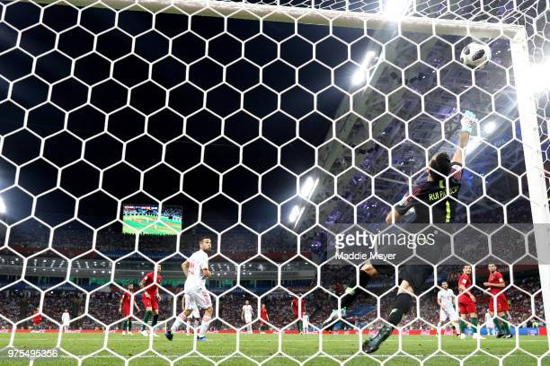 Goalkeeper Rui Patricio of Portugal fails to save a shot from Isco of Spain as ball hits the bar and bounces on the line during the 2018 FIFA World...
