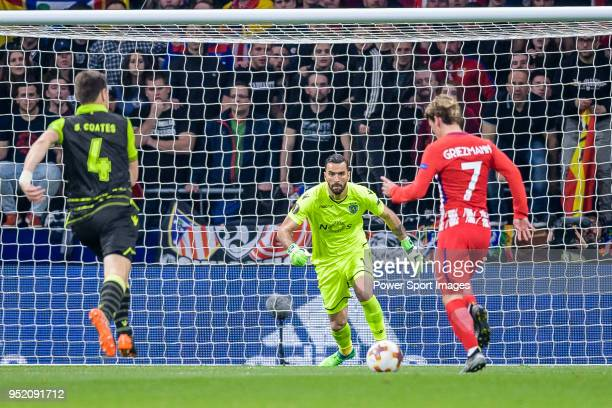 Goalkeeper Rui Patricio of Sporting CP reaches for the ball after an attempt at goal by Antoine Griezmann of Atletico de Madrid during the UEFA...