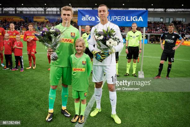 Goalkeeper Runar Alex Runarsson of FC Nordsjalland and Goalkeeper Hannes Thor Halldorsson of Randers FC receives flowers prior to the Danish Alka...