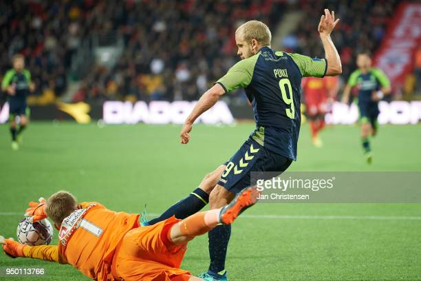 Goalkeeper Runar Alex Runarsson of FC Nordsjalland and Teemu Pukki of Brondby IF compete for the ball during the Danish Alka Superliga match between...