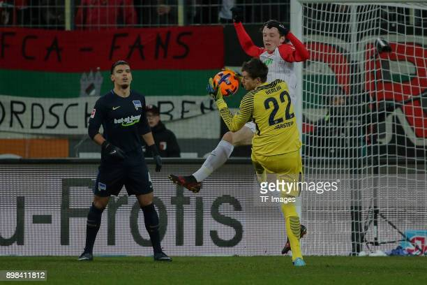 Goalkeeper Rune Jarstein of Hertha and Michael Grogoritsch of Augsburg battle for the ball during the Bundesliga match between FC Augsburg and Hertha...
