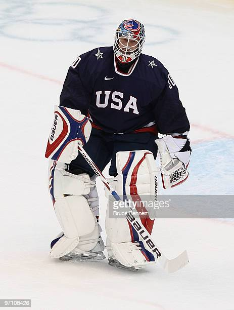 Goalkeeper Ryan Miller of the United States is replaces by goalkeeper Tim Thomas of the United States during the ice hockey men's semifinal game...