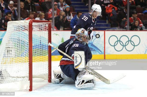 Goalkeeper Ryan Miller of the United States looks at the puck during the ice hockey men's semifinal game between the United States and Finland on day...