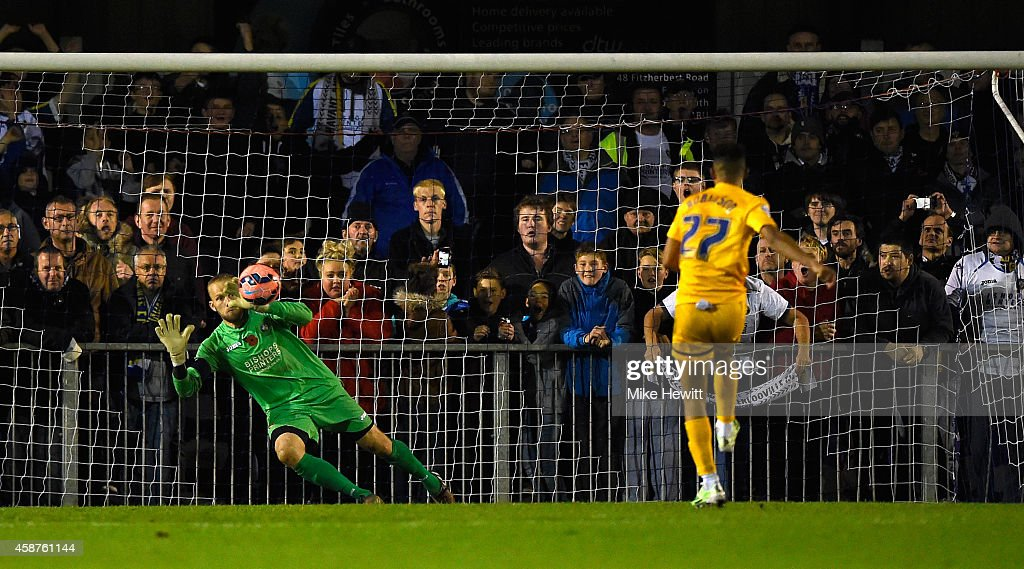 Goalkeeper Ryan Young of Havant can't prevent Callum Robinson from completing his hat-trick from the penalty spot during the FA Cup First Round match between Havant & Waterlooville FC and Preston North End on November 10, 2014 in Havant, England.