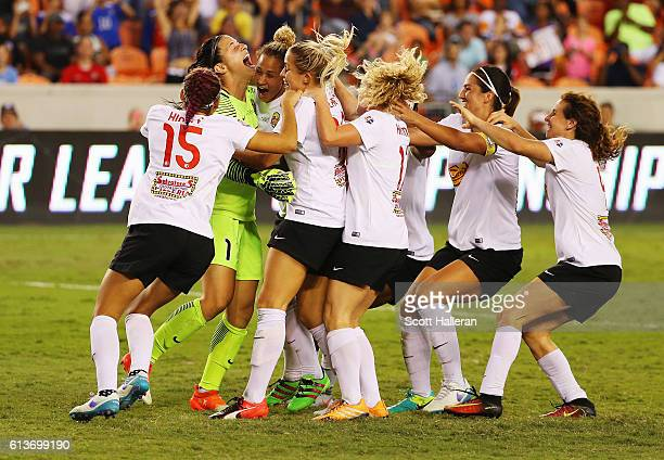 Goalkeeper Sabrina D'Angelo of the Western New York Flash celebrates with her teammates after defeating the Washington Spirit in a shootout during...