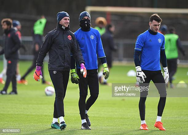 Goalkeeper Sam Johnstone David De Gea and Kieran O'Hara look on during a Manchester United training session on the eve of their UEFA Europa League...