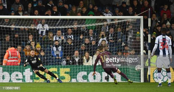 Goalkeeper Sam Johnstone looks on as Swansea player Bersant Celina misses his penalty during the Sky Bet Championship match between West Bromwich...