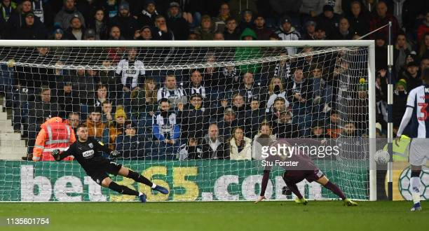 WBA goalkeeper Sam Johnstone looks on as Swansea player Bersant Celina misses his penalty during the Sky Bet Championship match between West Bromwich...